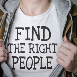 Man with the words Find the Right People on his t-shirt