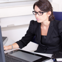 Women working at her computer on Microsoft Dynamics 365 Business Central doing Year End Process