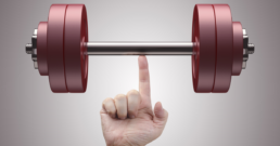 Weight lifting with just one finger. Concept of Power, strength and training.